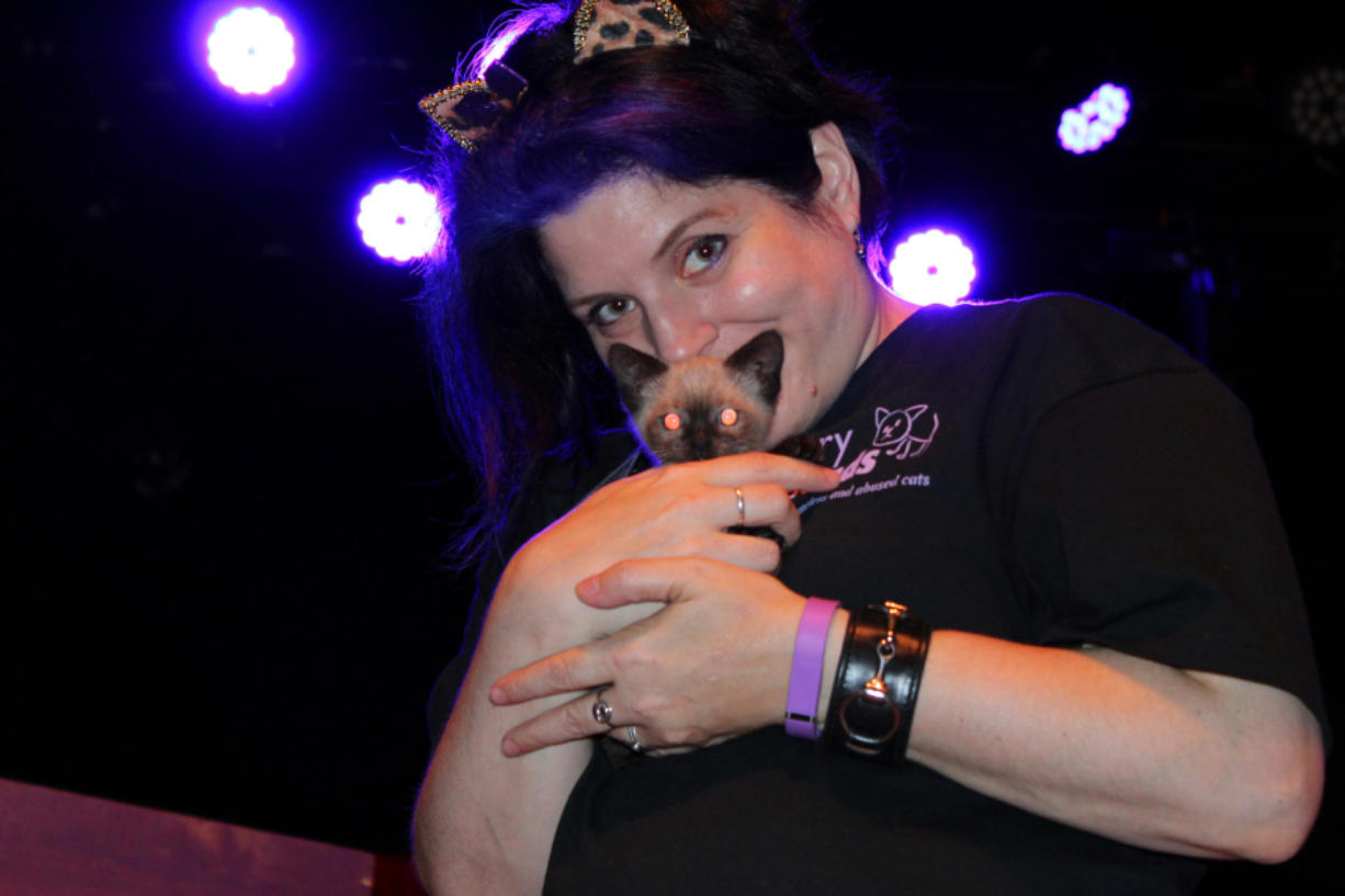 Walnut Grove: Furry Friends volunteer Marci Koski and one of the Amazing Acro-Cats at the Portland show for the traveling circus troupe, which donated $920 to the Vancouver-based shelter.