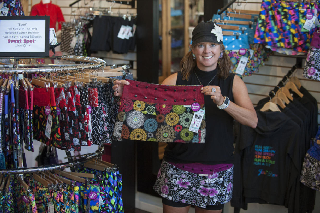 Stephanie Lynn shows one of her reversible skirts. Designed for active women, snaps allow the fit to be adjusted.