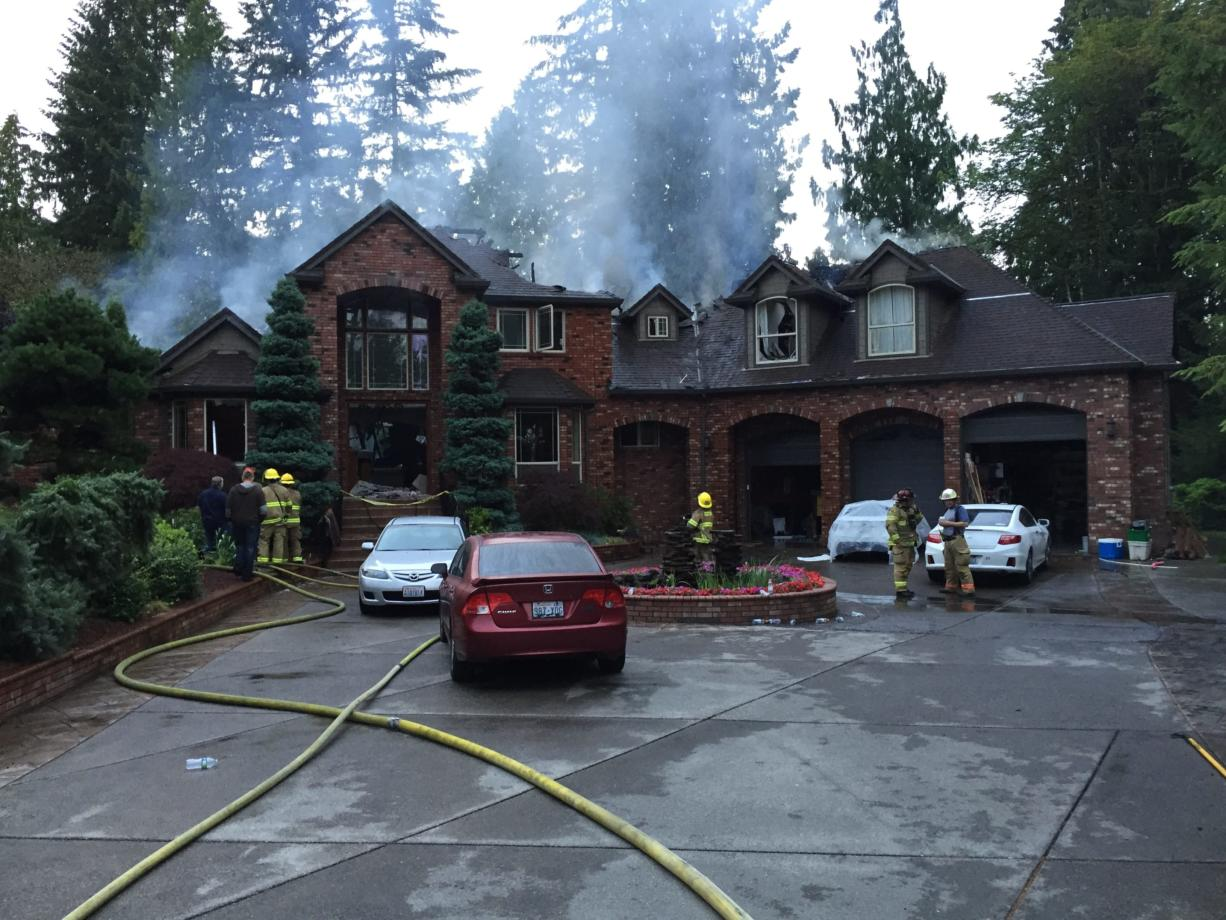 Fire badly damaged a 7,444-square-foot house just south of Battle Ground.