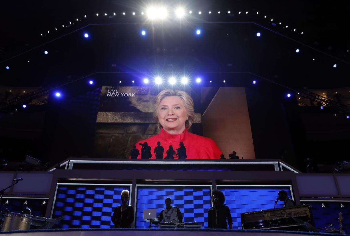 Democratic Presidential candidate Hillary Clinton appears on the screen during the second day session of the Democratic National Convention in Philadelphia, Tuesday, July 26, 2016.