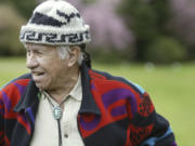 Billy Frank smiles as he walks along the Nisqually River near Olympia on April 14, 2005, where he was born and lived as a child. The Nisqually Indian elder and activist contributed leadership and multiple arrests to the battle fought by Northwest Indian tribes for their treaty-negotiated salmon-fishing rights.