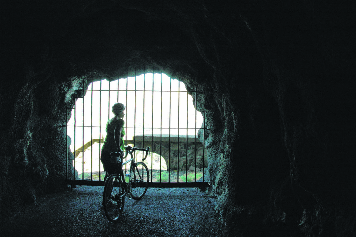 The openings in the Mosier Twin Tunnels, called adits, provide a refreshing breeze for cyclists and hikers using the Historic Columbia River Highway State Trail between Hood River and Mosier in Oregon.