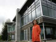 Kimberly Sherertz, widow of the late Vancouver businessman William Sherertz, stands in 2011 beside the unfinished waterfront restaurant that her husband had planned to open as The Black Pearl overlooking the marina at the Port of Camas-Washougal. The building is now for sale, allowing the Pearl to be passed to a hopeful restaurateur or other developer.