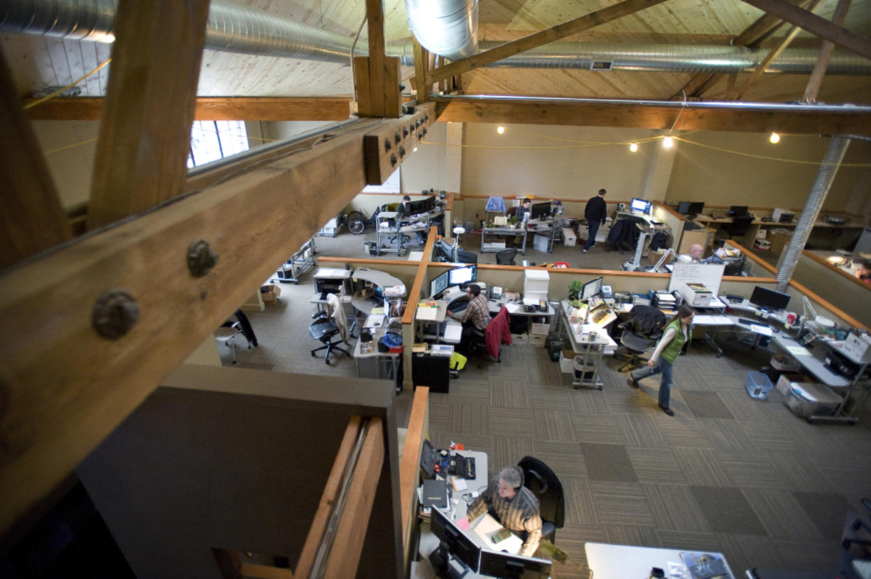 Employees get to work inside the Sigma Design office in a converted auto repair shop in 2011.