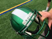 The Portland State University football team is mourning A.J. Schlatter (31) and Kyle Smith (67), players who died during the offseason. Also honored is Carder Doman, defensive end Michael Doman's son who died in June at age 2.
