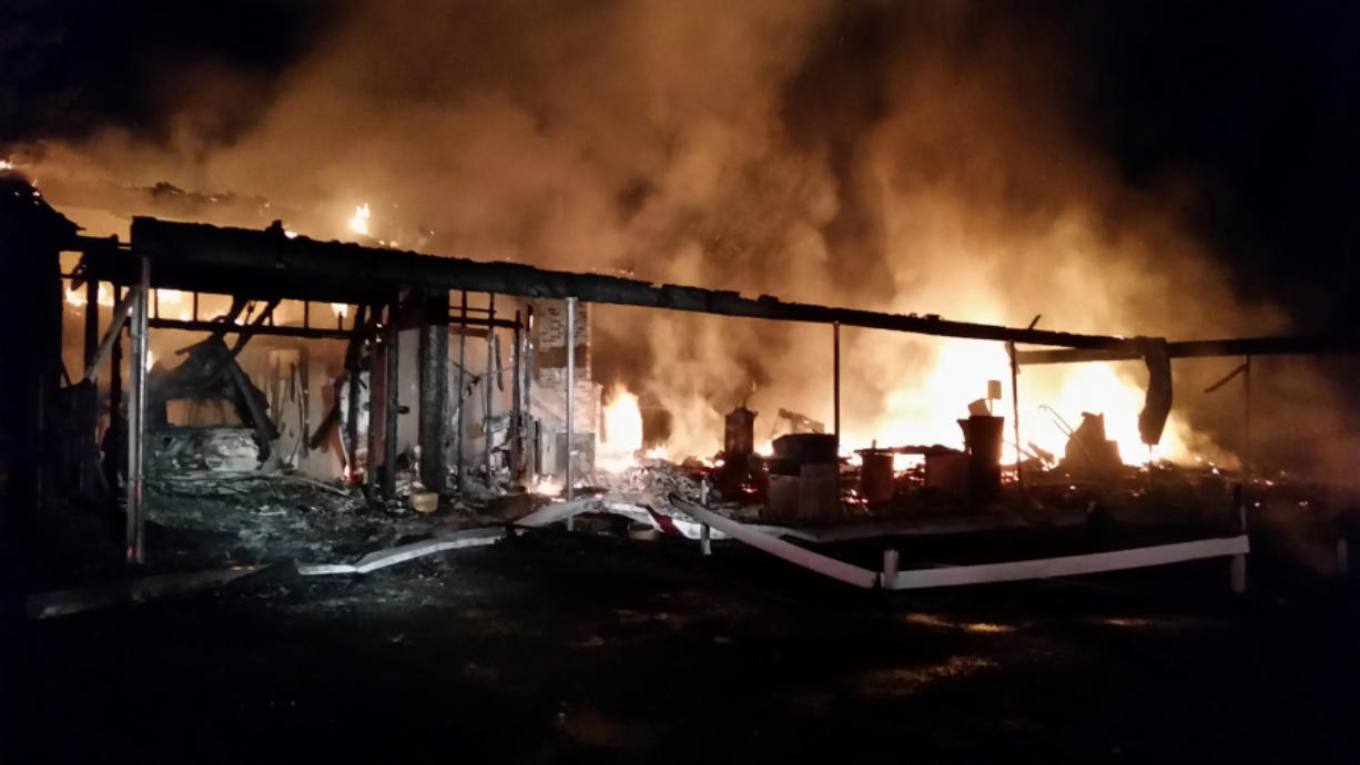 A house east of Washougal was destroyed in a blaze Friday night. Firefighters used a water tender to haul in water to douse the fire, which took crews hours to contain.
