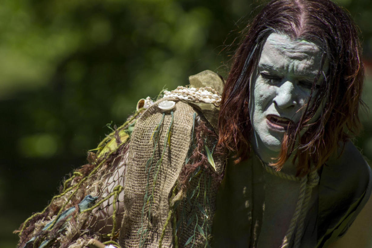 """Kerry Leek plays the enslaved monster Caliban in """"The Tempest."""" (Photo by Kathleen Kelly)"""