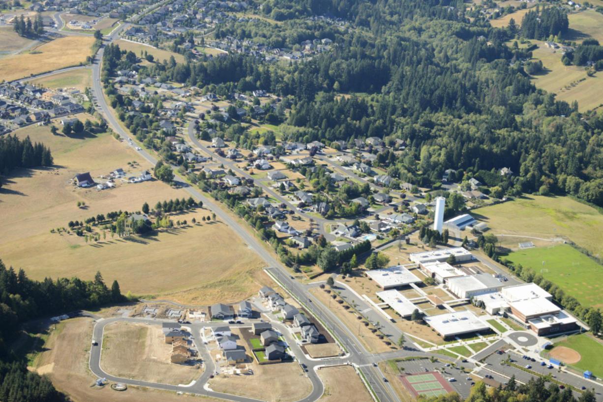 An aerial photo shows residential development along Hillhurst Road near Ridgefield High School.