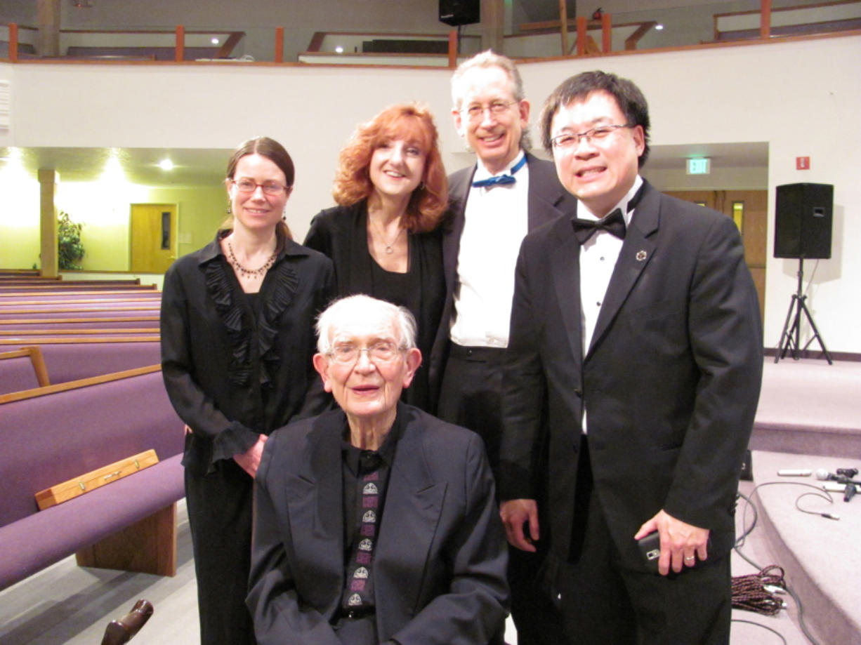 """From left, Rebecca Olsen (flute), Victoria Racz (oboe), Michael McCabe (guitar) and Michael Liu (piano) were among the musicians who pulled together in 2014 to perform a """"lifetime recognition"""" concert of works by Matt Doran, front and center."""