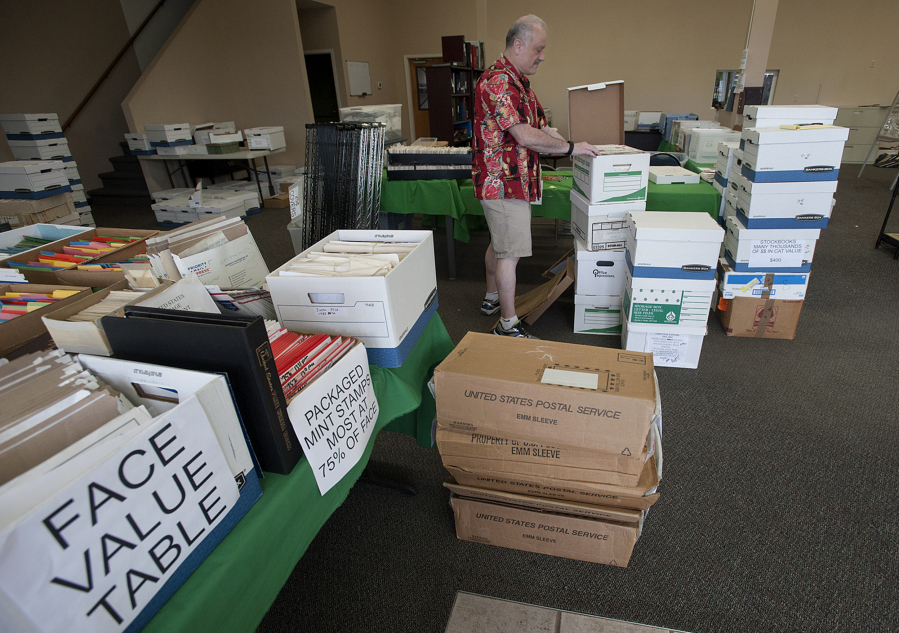 Vancouver Stamp Dealer Michael Jaffe Prepares Some Of His Inventory For The National Show