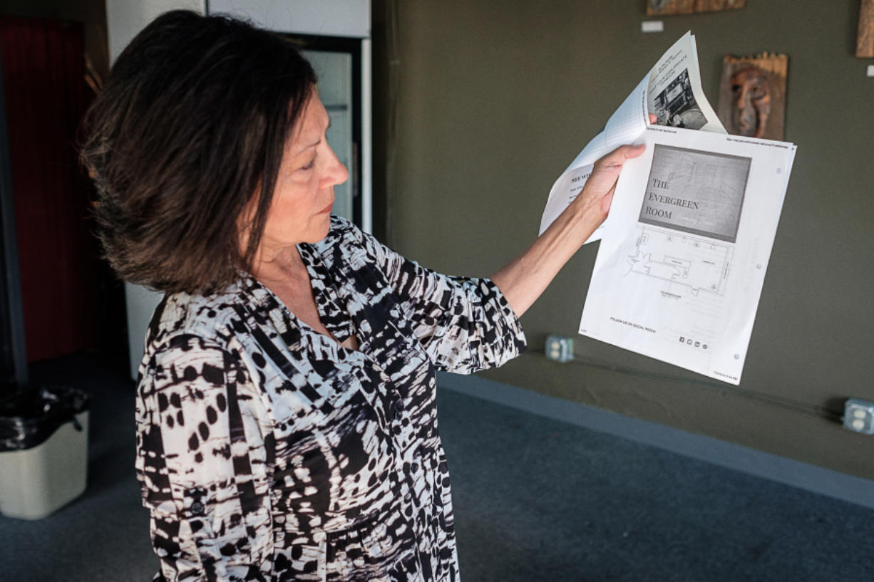 """Arlene Nunez, owner of By the Bottle, explains her future plans for the business in downtown Vancouver on Friday.  The Evergreen Room, in By the Bottle's current location at 108 W. Evergreen Blvd., will be """"Vancouver's private taproom,"""" a small banquet space with beer and catered food."""