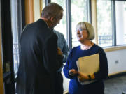 "Sen. Patty Murray speaks to David Ripp, the executive director of the Port of Camas-Washougal, following a Columbia River Economic Development Council luncheon on Tuesday. The Democratic senator spoke about her collaborative efforts in ""the other Washington"" before a crowd of more than 90 local business leaders."