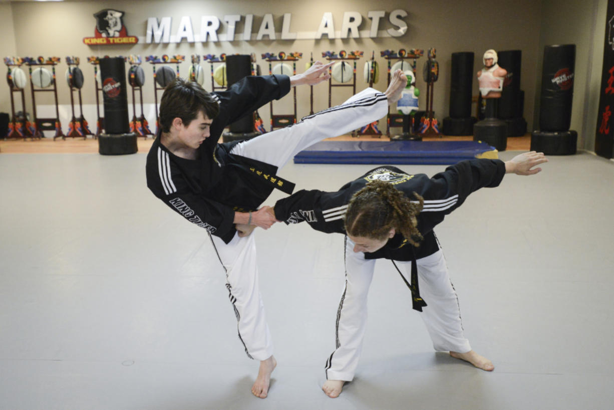 Seventeen-year-old Aiden Bartocci, left, and sixteen-year-old Enzo LaFont practice at King Tiger Martial Arts in Vancouver, Tuesday August 23, 2016. The Vancouver teens are going to South Korea in September to represent the USA at the first World Martial Arts Mastership.