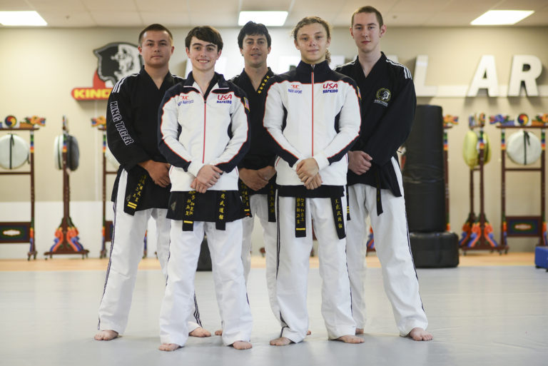 Seventeen-year-old Aiden Bartocci, front left, and sixteen-year-old Enzo LaFont, front right, take a break from practice with their classmates during practice at King Tiger Martial Arts in Vancouver, Tuesday August 23, 2016. Bartocci and LaFont are going to South Korea in September to represent the USA at the first World Martial Arts Mastership.