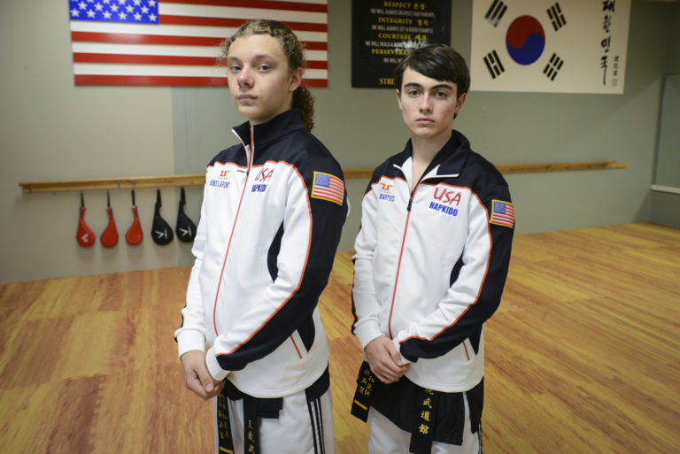Sixteen-year-old Enzo LaFont, left, and seventeen-year-old Aiden Bartocci, right, take a break during practice at King Tiger Martial Arts in Vancouver, Tuesday August 23, 2016. The Vancouver teens are going to South Korea in September to represent the USA at the first World Martial Arts Mastership.