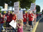 Teachers and community members picket Friday at Evergreen High School amid contract negotiations.