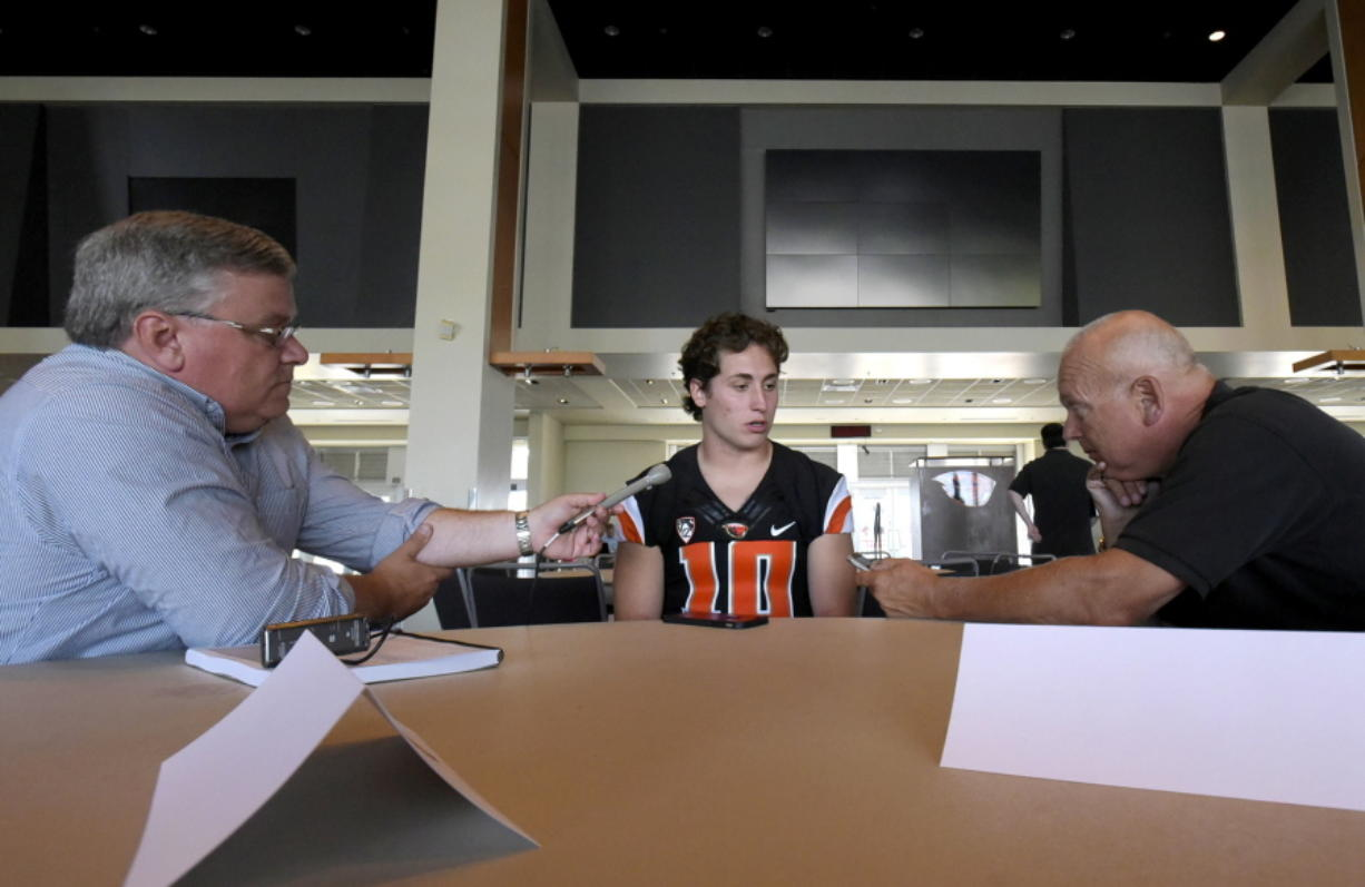Reporters talk to Oregon State quarterback Darell Garretson during the NCAA college football team's media day at Reeser Stadium in Corvallis, Ore., on Tuesday, Aug. 2, 2016.