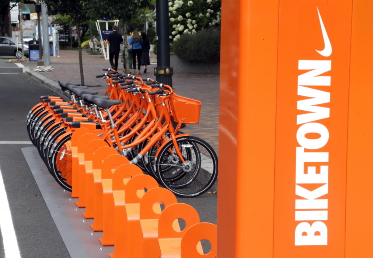 Bicycles stand at the ready in July for use in a bike-sharing program in Portland called Biketown. Portland residents have ridden 136,000 miles on bike-share program bikes since the program launched in July, according to the program.