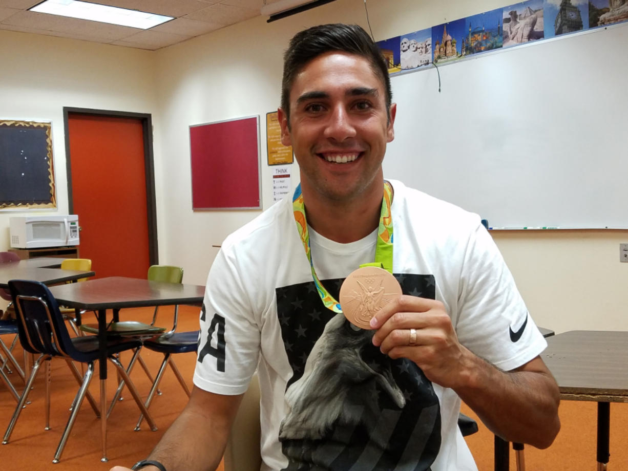 Taylor Sanders, U.S. men's volleyball Olympian shows his bronze medal on Thursday, Sept. 8, 2016, at Prairie High School. He was a guest at the match between Prairie and Skyview.