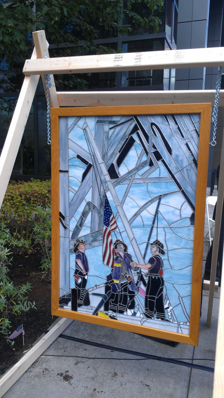 Woodland resident Gerald Siegel donated his stained glass art depicting New York Firefighters raising the American flag at Ground Zero to the city of Vancouver. The piece was unveiled Sunday at a Patriot Day ceremony in Vancouver honoring victims of the 9/11 terrorist attacks. (Stevie Mathieu/The Columbian)