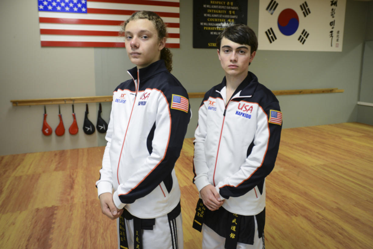 Sixteen-year-old Enzo LaFont, left, and 17-year-old Aiden Bartocci, right, take a break during practice at King Tiger Martial Arts in Vancouver.
