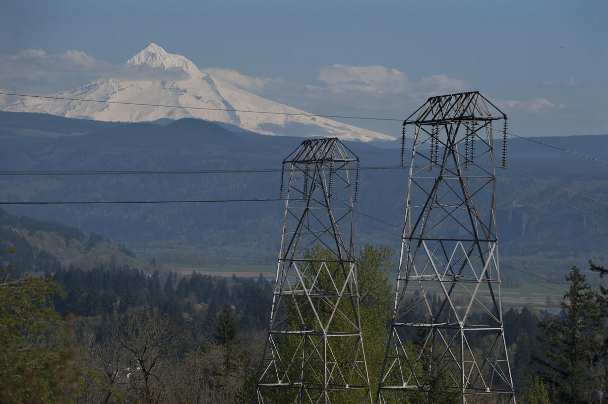 High voltage power lines are seen looking east from Oak Creek Park as Mt. Hood is visible in the background in April in Camas. (Amanda Cowan/The Columbian)