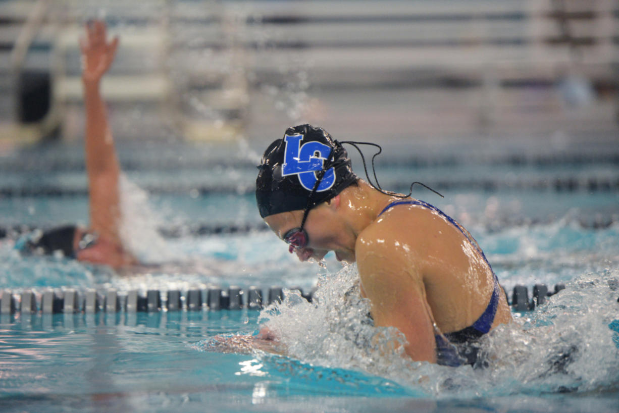 La Center freshman Hailey Grotte swims with the Hockinson swim team at the Clark County Family YMCA in Vancouver on Monday, September 26, 2016. Grotte is the first and only female to swim for La Center High School.
