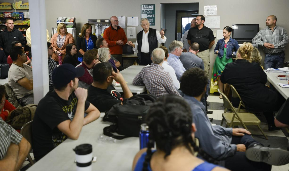 CEO of Cadet Dick Anderson, center back, announces to employees that he is selling the business to an Irish company, Glen Dimplex, Wednesday September 21, 2016 at Cadet in Vancouver. (Ariane Kunze/The Columbian)