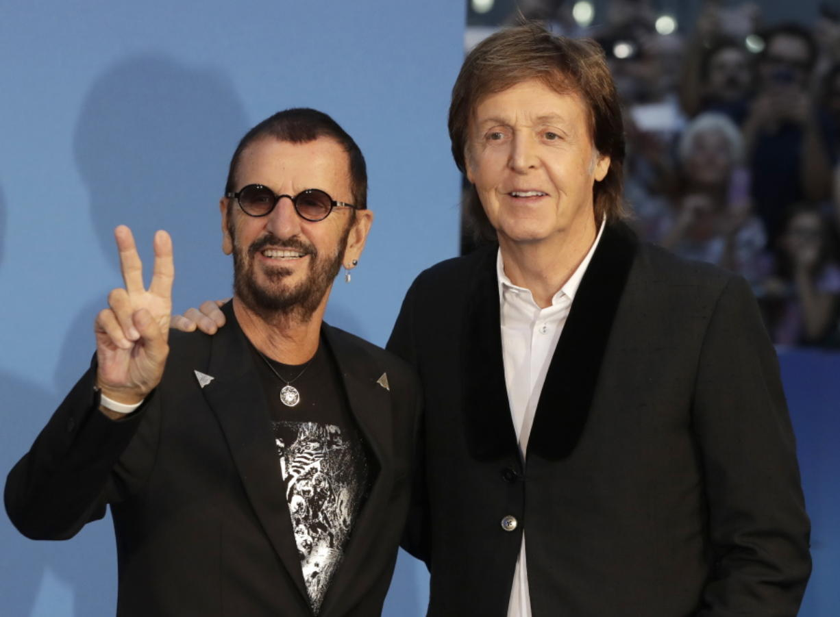"Musicians and former Beatles Paul McCartney, right, and Ringo Starr pose for photographers at the World premiere of the Beatles movie, Ron Howard's ""Eight Days a Week -- The Touring Years"" in London. (Kirsty Wigglesworth/Associated Press)"
