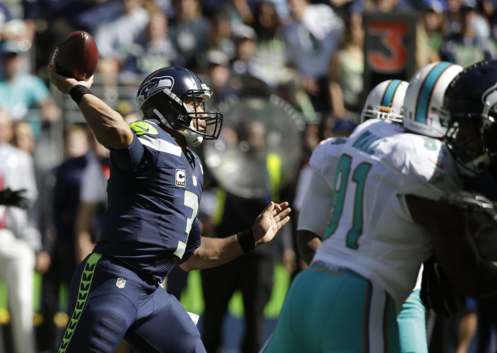 f46c20542 Seattle Seahawks quarterback Russell Wilson passes against the Miami  Dolphins in the first half of a