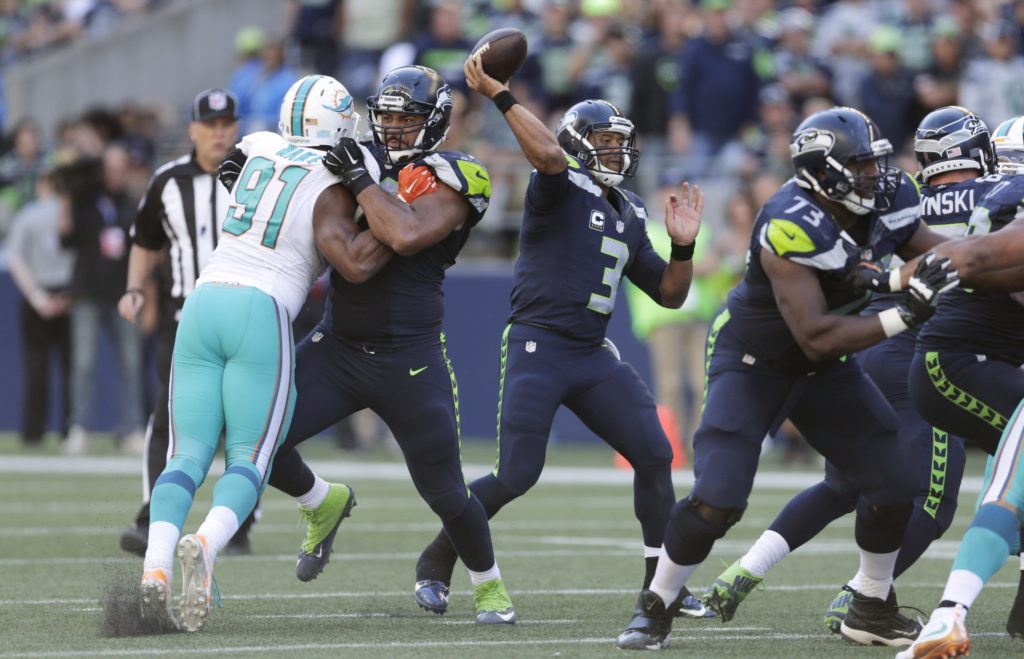 7486f7020 Seattle Seahawks quarterback Russell Wilson (3) passes against the Miami  Dolphins in the second