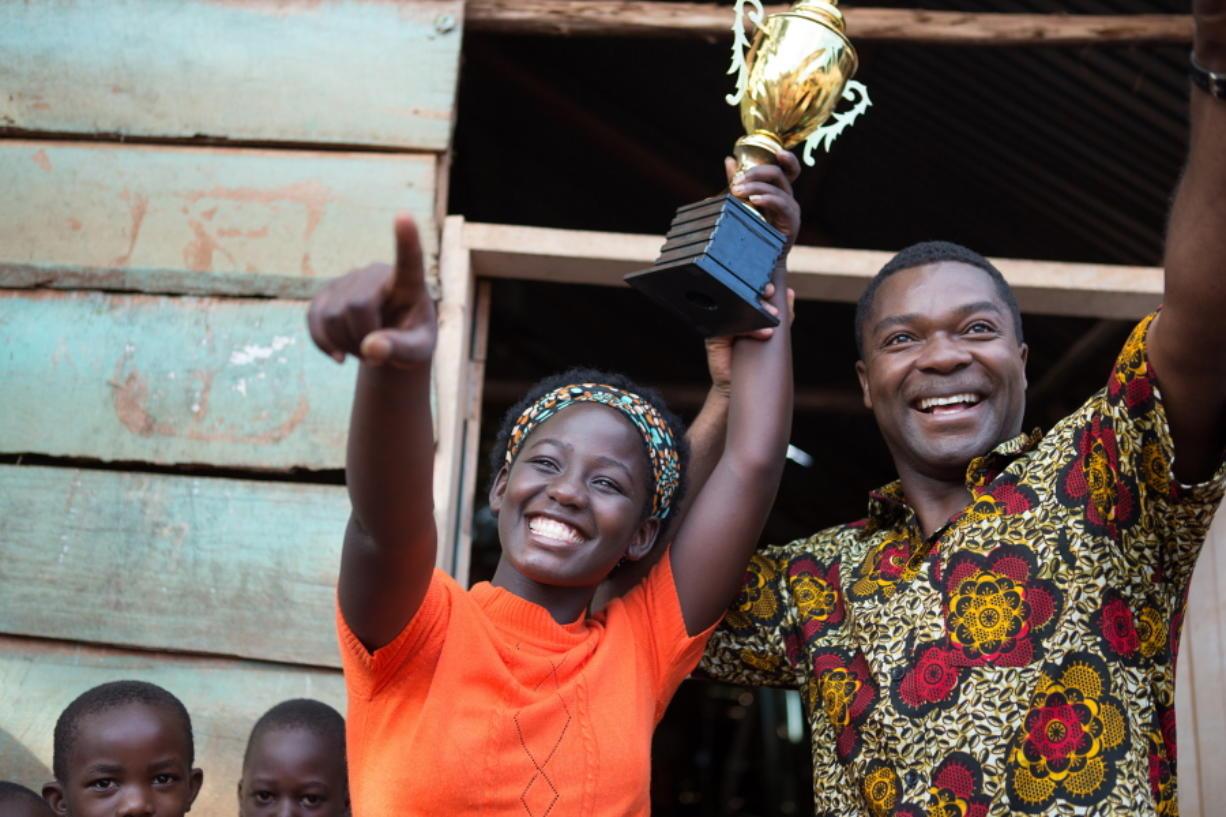 "Madina Nalwanga, left, and David Oyelowo appear in a scene from ""Queen of Katwe."" (Edward Echwalu/Disney)"