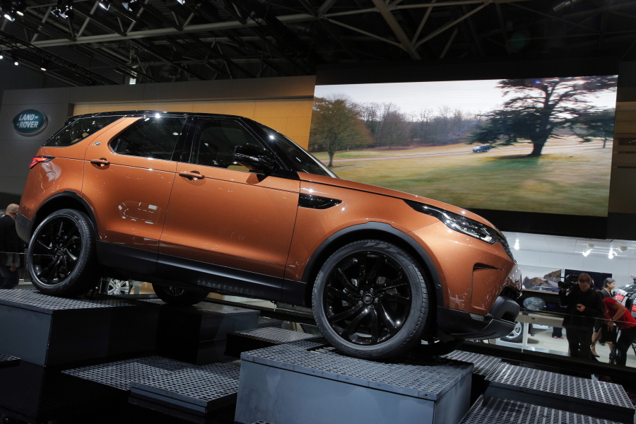 Five Cars That Stand Out At Paris Auto Show The Columbian - Car show wheel stands