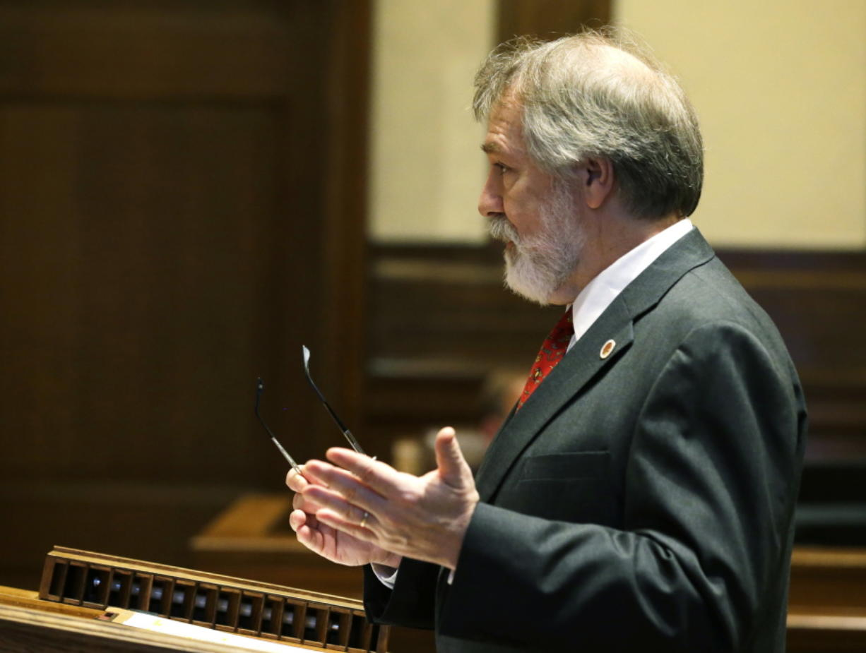 Alan Copsey, a deputy attorney general for the state of Washington, speaks during a hearing before the Washington State Supreme Court regarding a lawsuit against the state over education funding, Wednesday, Sept. 7, 2016, in Olympia, Wash. The state wants the court to remove a contempt order and $100,000-a-day sanctions that have been accumulating for more than a year and which are supposed to be set aside into an education account.  (AP Photo/Ted S.