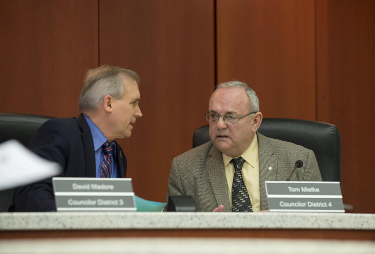 Clark County Councilors David Madore and Tom Mielke take a moment to chat before the start of a March 22 meeting at the Clark County Public Service Center.
