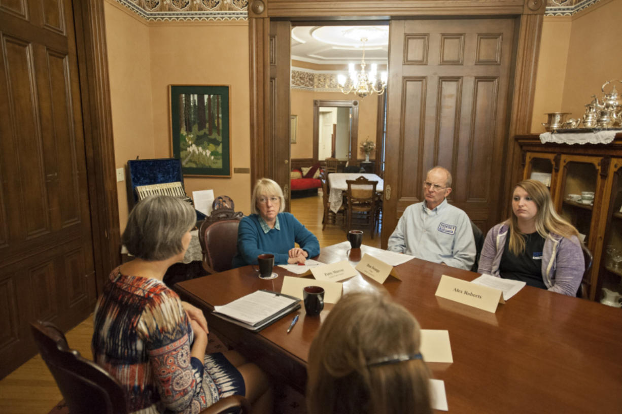 Jeanne Bennett of Workforce Southwest Washington, from left, speaks with U.S. Sen. Patty Murray, D-Wash., as Don Orange and Alex Roberts of Hoesly Automotive look on Wednesday morning at the Marshall House in Vancouver. Murray was in town to talk about guaranteed sick leave.