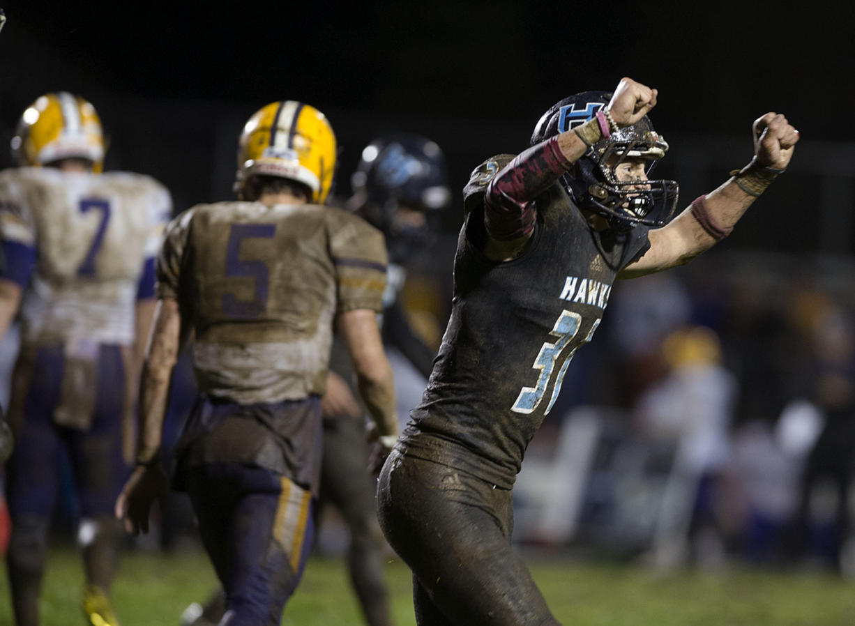 Hockinson's Wyatt Jones (31) celebrates after a Columbia River field goal attempt is no good in the third quarter at Hockinson High School on Friday night, Oct. 14, 2016.