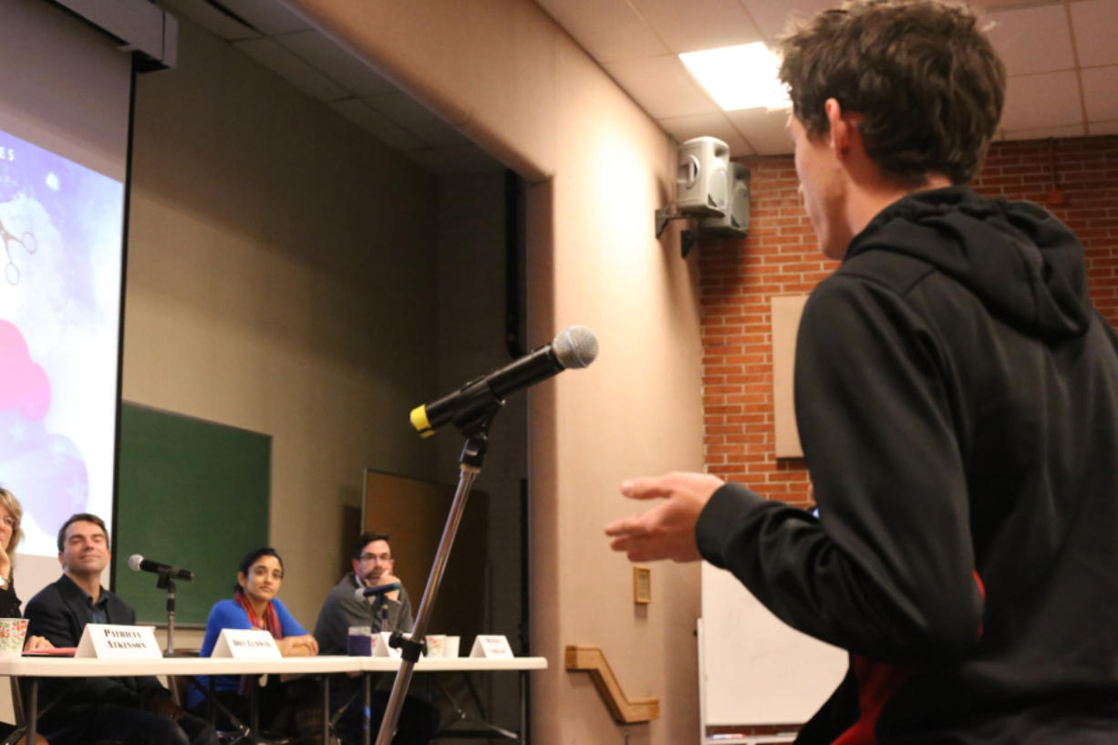 """Young people and Clark College faculty talked about wealth disparity and social injustice during a panel discussion titled """"Income Inequality: Is the American Dream at Risk?"""" Thursday at Clark College. (Troy Brynelson/The Columbian)"""