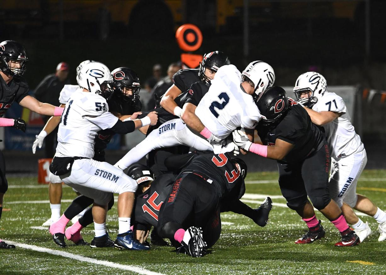 Skyview quarterback Brody Barnum (2) is stopped by Camas defenders during Friday's game at Doc Harris Stadium. Camas won 31-9.