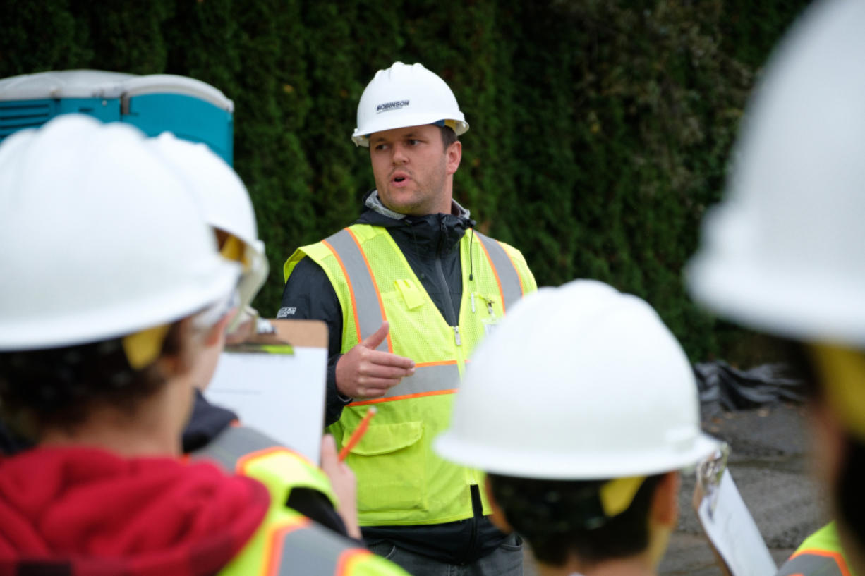 Robinson Construction Project Manager Bryan Kenney, center, talks to Hockinson Middle School students before a tour of the construction site of the future middle school.