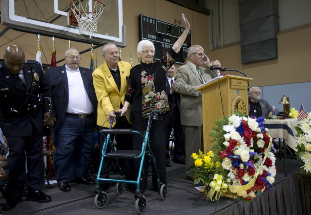 "Waving to the crowd, Rae Cheney, 96, acknowledges the applause after describing how the death of her son Lt. Dan Cheney in Vietnam led to a family legacy of ""turning sorrow into service."" They started an outreach program, PeaceTrees Vietnam."