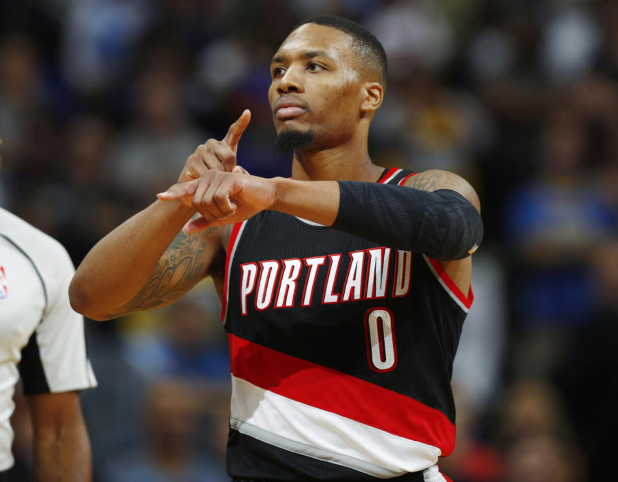 Portland Trail Blazers guard Damian Lillard gestures after hitting the winning basket with .3 seconds remaining in overtime of an NBA basketball game against the Denver Nuggets on Saturday, Oct. 29, 2016 in Denver. Portland won 115-113.