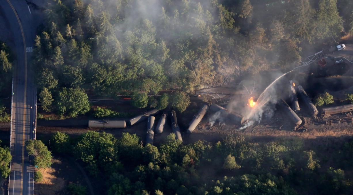 An oil train burns near Mosier, Ore., after derailing June 3.