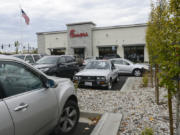 Customers try to find parking in the crowded Chick-Fil-A parking lot in east Vancouver.