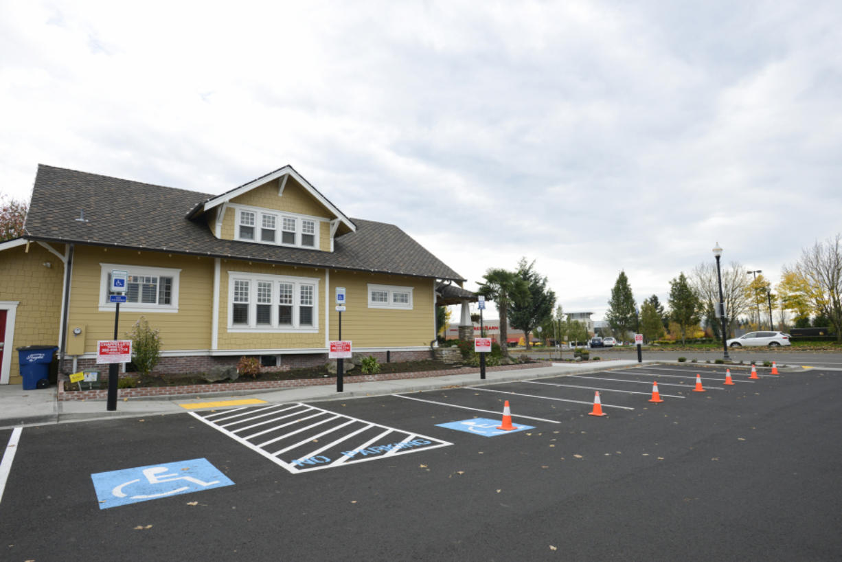 Cones and towing signs line the shared parking lot of the real estate office of Terrie Cox and Chick-fil-A on Southeast Mill Plain Boulevard.