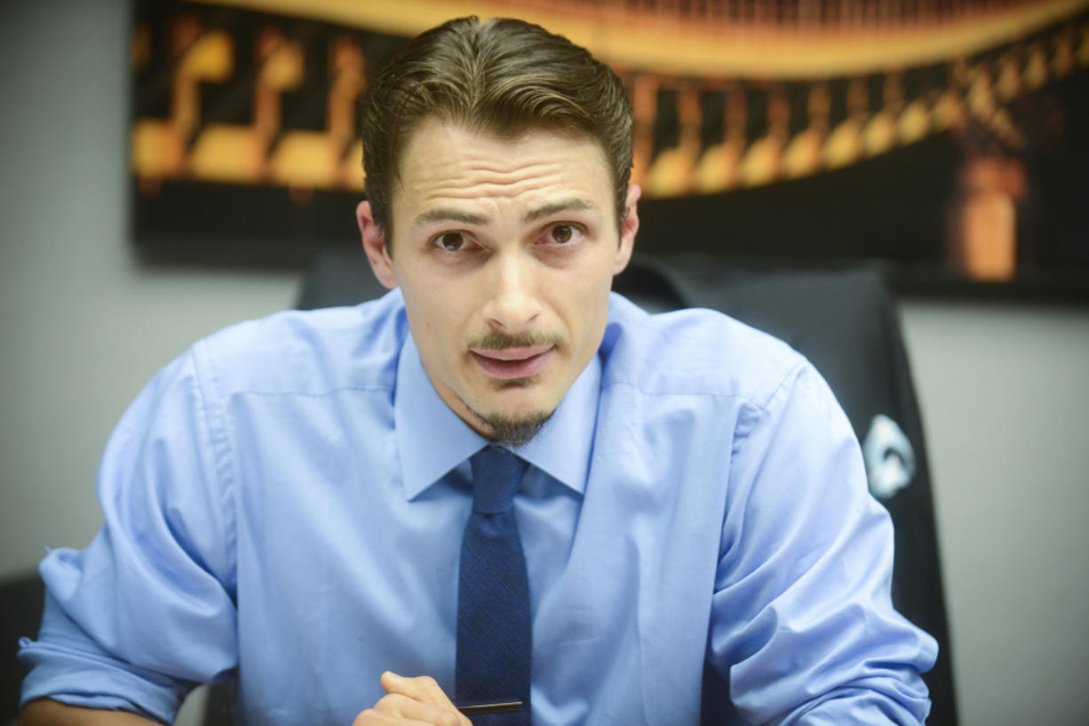 Justin Forsman of Vancouver speaks at a Columbian editorial board meeting in July during his unsuccessful campaign for state Senate. Forsman, who has a felony criminal history, intends to file a suit in federal court in an attempt to have his right to own firearms restored. (The Columbian files)