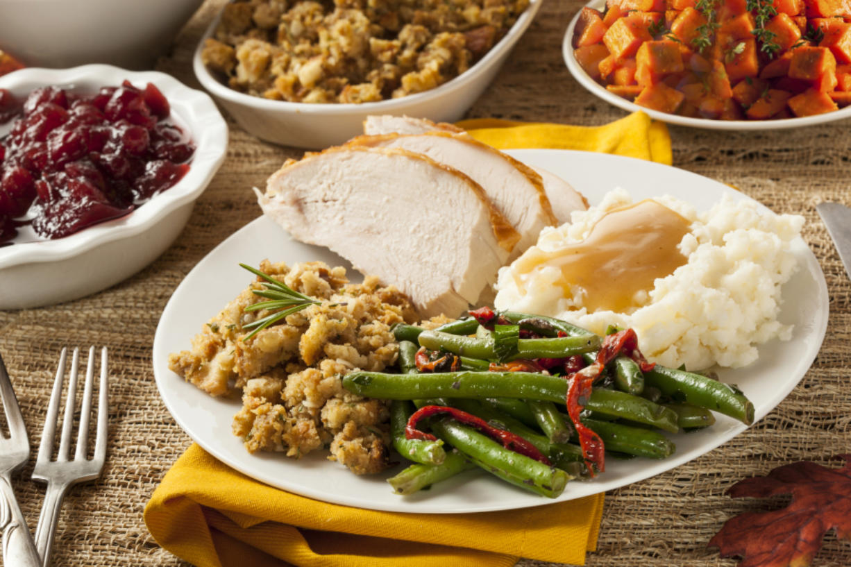 Homemade turkey Thanksgiving dinner with mashed potatoes, stuffing, and green beans.