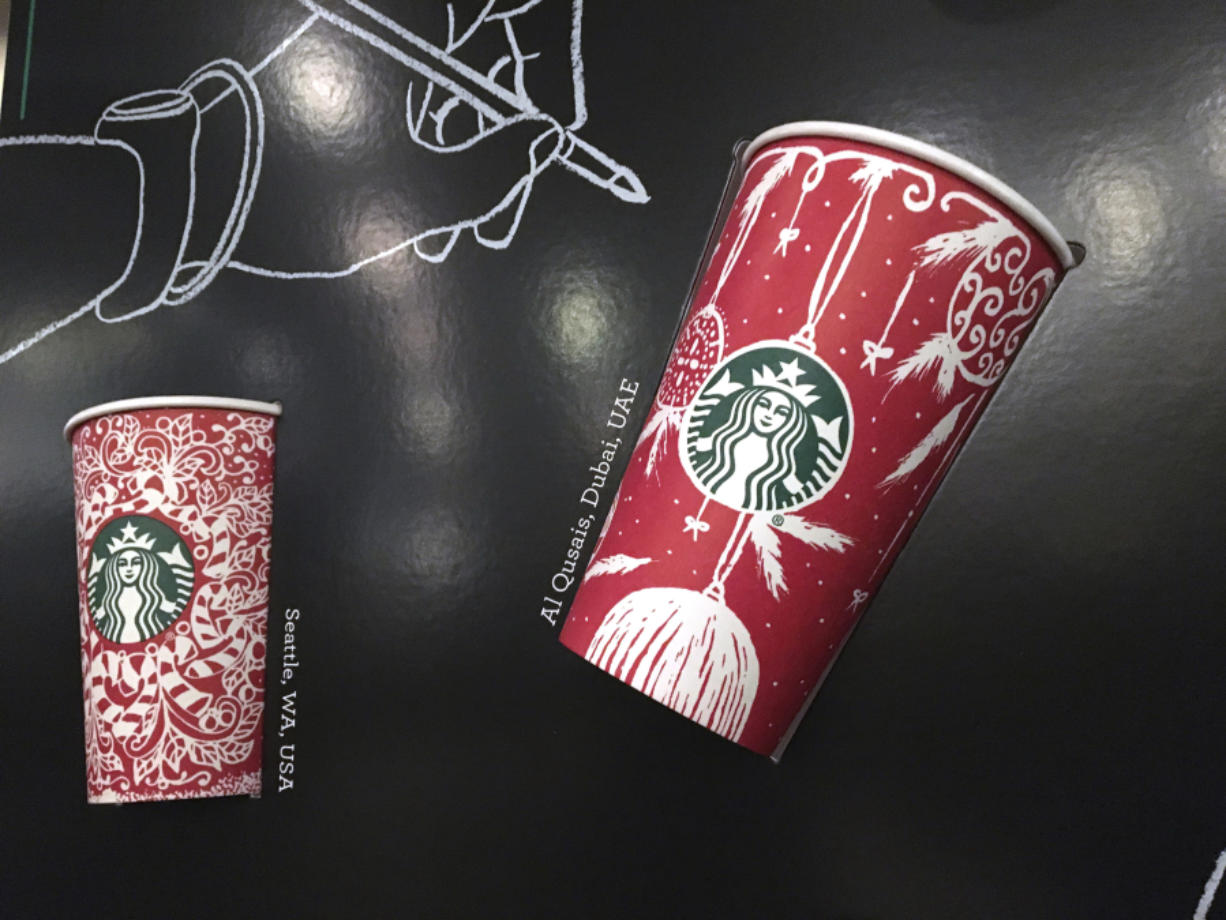 Starbucks holiday cups appear on display at a store in New York. Snowflakes, reindeer and candy canes are back on Starbucks holiday coffee cups, after last year's plain red cups caused uproar from critics who said the chain was part of a so-called war on Christmas.