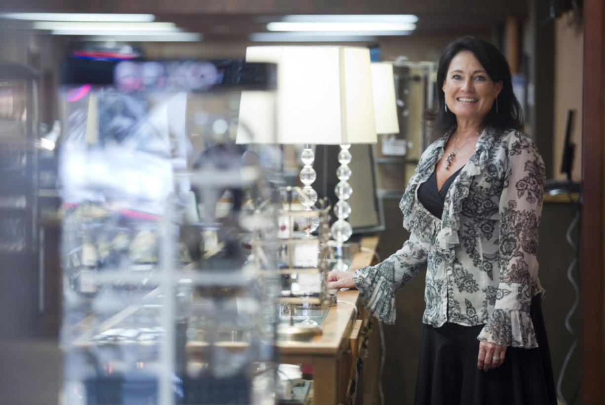 Debbie Runyan-Parker is the third-generation owner of Runyan's Jewelers in Camas. The store is celebrating its 70th anniversary. (Natalie Behring for the Columbian)