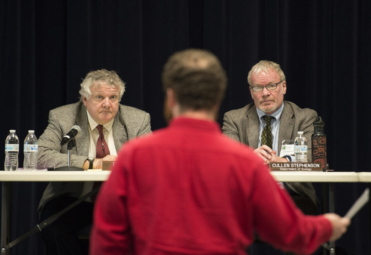Energy Facility Site Evaluation Council members Bill Lynch, left, and Cullen Stephenson listen Tuesday as Ryan Rittenhouse of Friends of the Columbia Gorge speaks during a hearing on a Vancouver Energy permit.